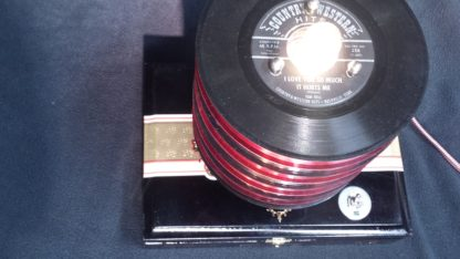 A top down view of Red & Black 45 records on top of this black My Father cigar box. Perfect Vinyl Collector Gift